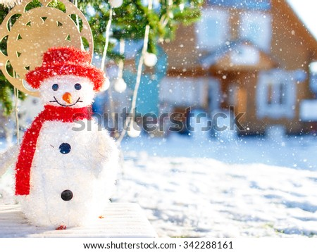 snowman. snowbound Christmas Eve. smiling snowman under a decorated Christmas tree in the square - stock photo