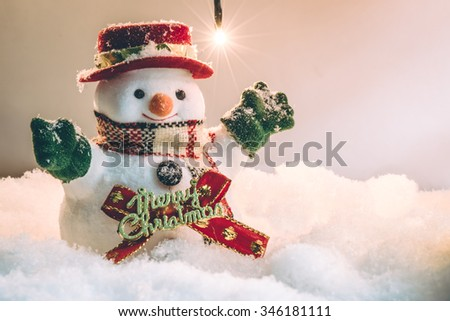 Snowman stand in silent night with a light bulb, light up the hopefulness and happiness in Merry christmas and new year night.