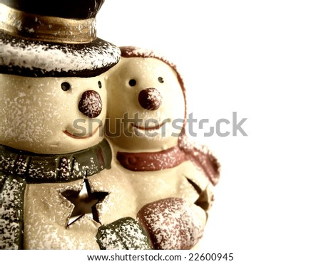 Snowman statue pair - stock photo