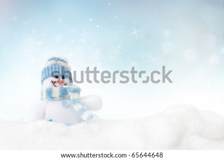 Snowman toy on the frozen winter background - stock photo