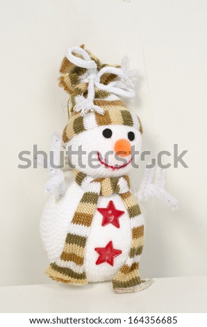 Snowman wearing hat and scarf  - stock photo