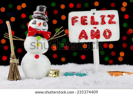 Snowman with a Happy New Year signpost written on spanish - stock photo