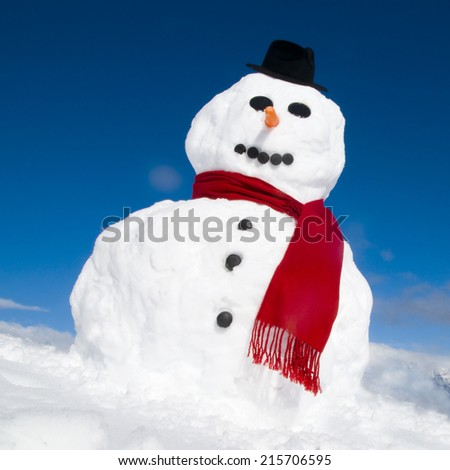 Snowman with a red scarf. - stock photo