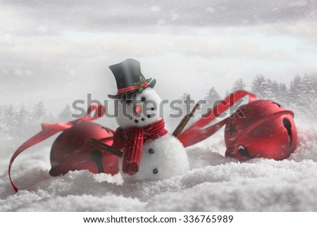 Snowman with bells in snowy winter background - stock photo