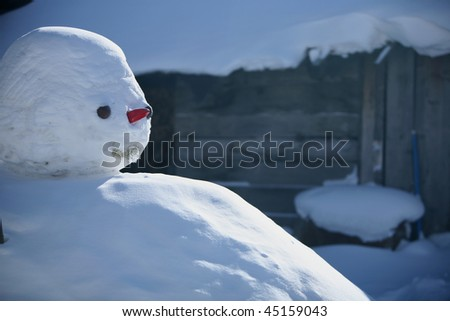 snowman with red nose - stock photo