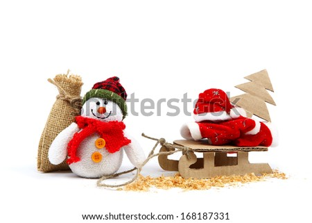 Snowman with sackcloth bag and sledge, Christmas tree, Santa Claus clothes isolated on a white background.