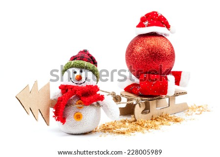 Snowman with sled, Christmas tree and New Year's ball isolated on a white background. - stock photo