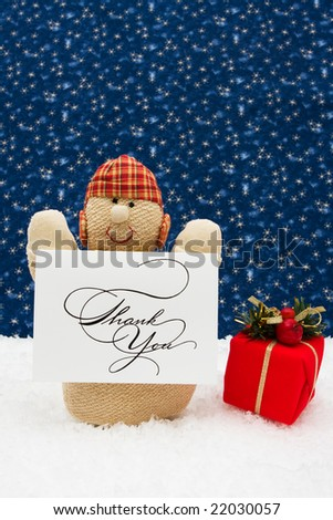 Snowman with thank you card and presents on a star background, Snowman - stock photo