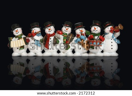 Snowmen playing music instruments isolated over black with reflection - stock photo