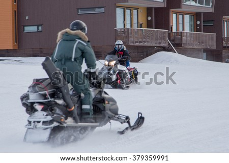 Snowmobile is the best transportation  in Longyearbyen, Spitsbergen (Svalbard). Norway - stock photo