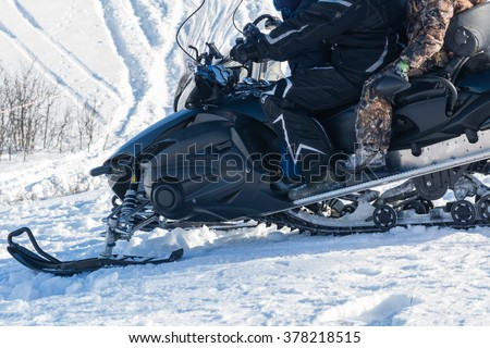 Snowmobile on the snow