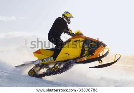 Snowmobile racing. - stock photo