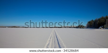 Snowmobile track in snowlandscape