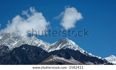 Snowpeaks in Himalayas. India. Himachal Pradesh. - stock photo