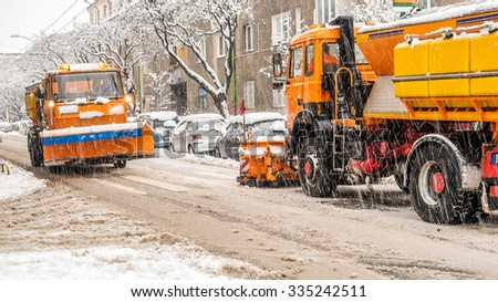 snowplough making shoveling roads - stock photo