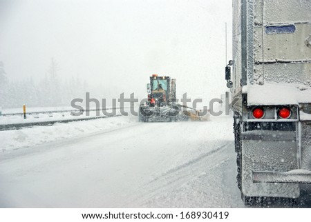 Snowplow and trucks during snowstorm in    Oregon, Pacific Northwest - stock photo
