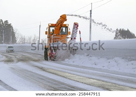 Snowplow Cleaning the road