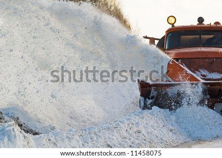 Snowplow removing snow from intercity road from snow blizzard - stock photo
