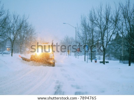 Snowplowing Truck in Blizzard