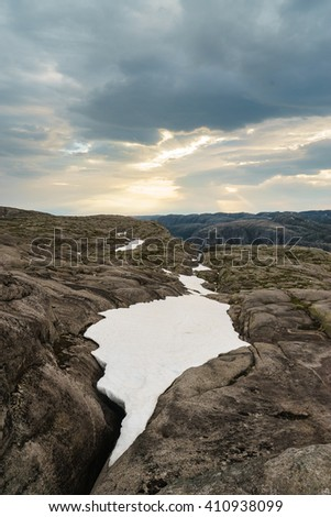 Snows on The trail to Kjeragbolten Kjerag mountain, Lysefjord. Norway - stock photo