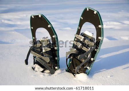 Snowshoeing. Snowshoes in the snow. Photo from Quebec, Canada. - stock photo