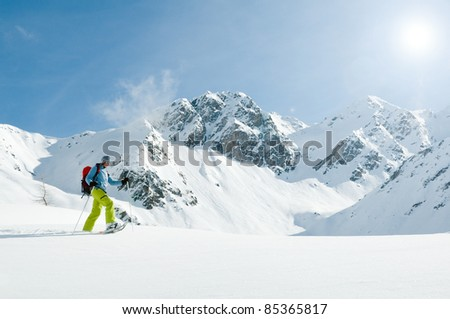 Snowshoeing - woman trekking in winter mountains (copy space) - stock photo