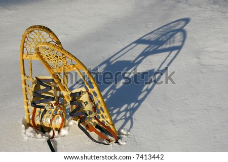 Snowshoes after a light winter snow fall. - stock photo