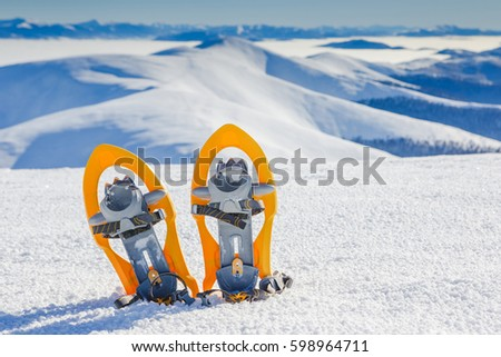 Snowshoes in snow in winter mountains