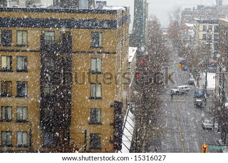 Snowstorm in downtown Vancouver near Pender and Abbott Streets in a rare moment - stock photo