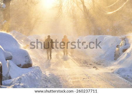 Snowstorm in the city - stock photo