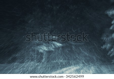 snowstorm on a country road at night, view from a car, natural photography - stock photo