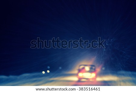snowstorm on a country road at night, view from a car, natural photography