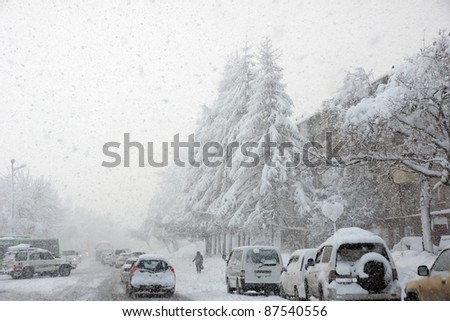 snowstorm, poor visibility,slick roads and lots of traffic - stock photo