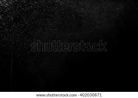 Snowstorm texture,Water dust in motion like snow,Watercolor background,shower water drops,abstract splashes of water on a black background