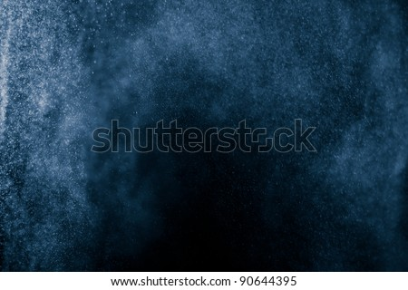 Snowstorm.Water dust in motion like snow. Abstract Background
