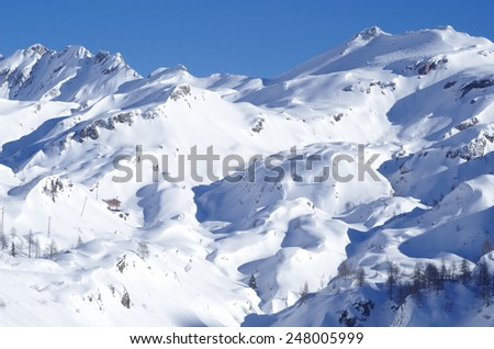 Snowy Alps - Majestic views of the high Italian Alps in winter. - stock photo