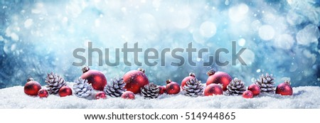Snowy Christmas Balls And Pinecones In Frost Scene