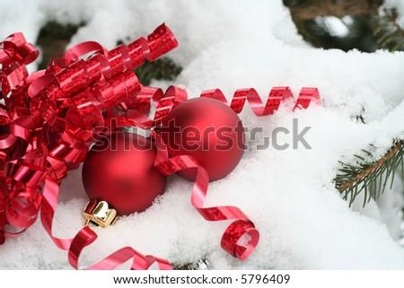 Snowy Christmas ornaments outside - stock photo