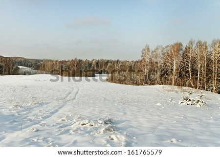 Snowy field in the morning. - stock photo