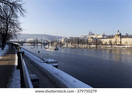 Snowy foggy Prague Lesser Town with gothic Castle, Czech republic - stock photo