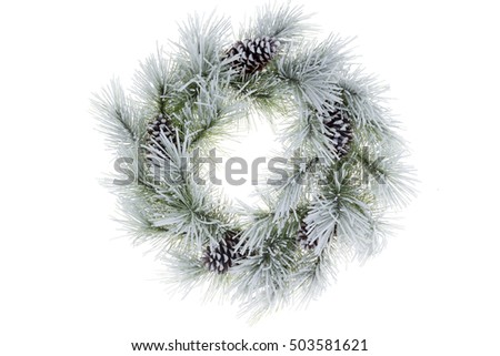 Snowy frosted natural pine circular Christmas wreath with cones isolated on white background for your seasonal holiday themes