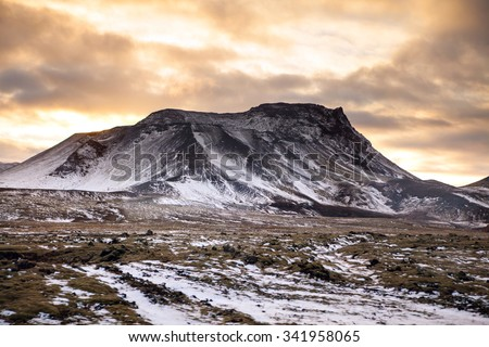 Snowy Icelandic mountains with dramatic cloudy sky - amazingly peaceful landscape of Iceland. - stock photo