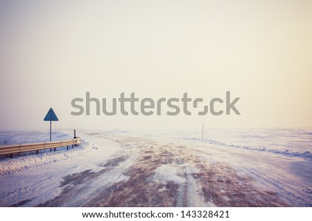 snowy land road at winter - stock photo