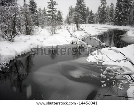 Snowy landscape with windy creek in Whistler British Columbia - stock photo