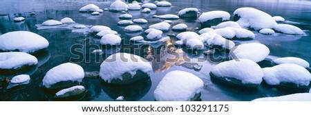 Snowy Merced River with reflection of Half Dome, Yosemite, California - stock photo