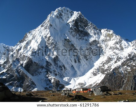 Snowy Mountain and village - stock photo
