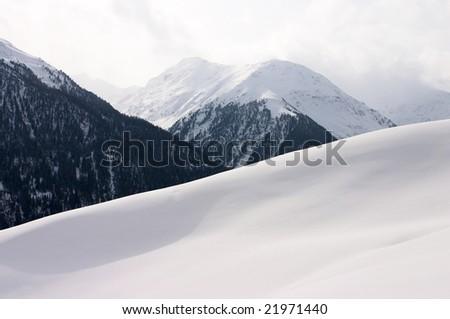 Snowy mountain landscape (Switzerland) - stock photo