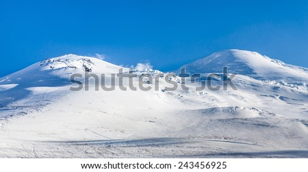 Snowy mountain peaks. View of Mount Elbrus from the North, Caucasus mountain range, Russia - stock photo