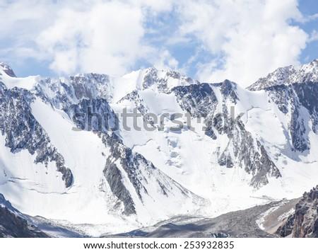 Snowy mountain range in Kyrgyzstan - stock photo