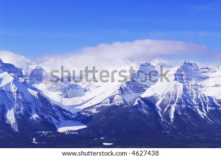 Snowy mountain ridge at Lake Louise in Canadian Rockies in winter - stock photo